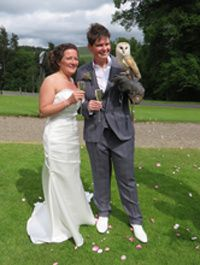Happy couple with lovely owl