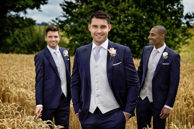 Ivory waistcoat with navy suit