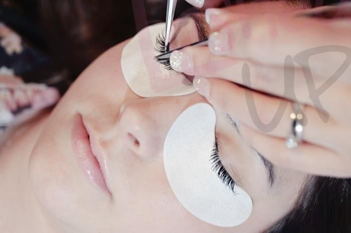 Lashes being applied