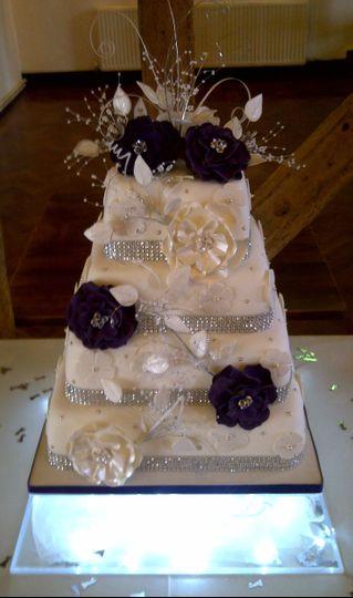 White and purple square cake
