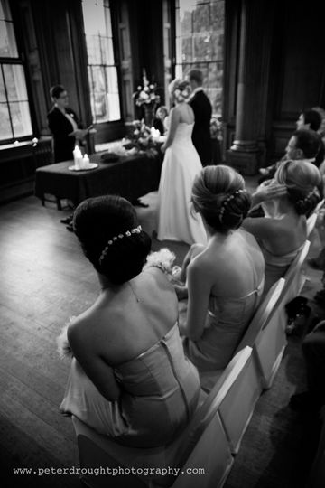 Bridesmaids looking on.