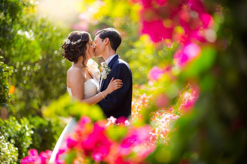 Newlyweds in venue garden