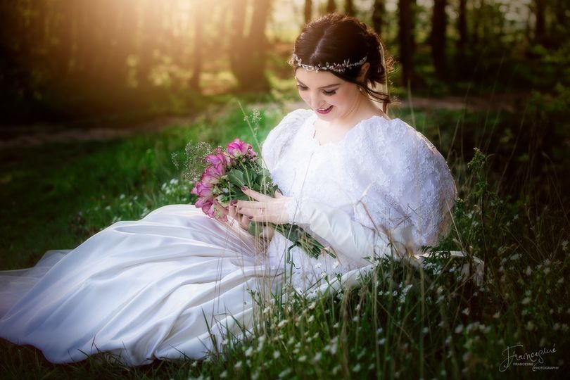 Bride sits amongst the daisies