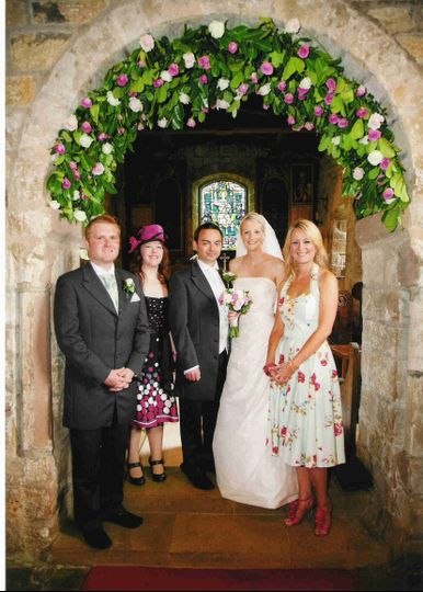 Church arch and wedding party