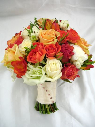 A stunning bouquet of oranges, peaches and creams