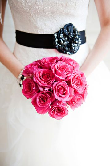 Handtied bouquet of hot pink roses