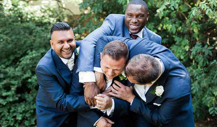The groom feeling the love