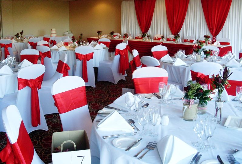 Chair covers and red sashes