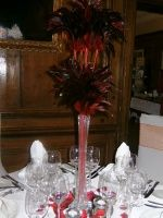 Feather spray centrepieces with mirror base and tea lights for only 25 pounds each