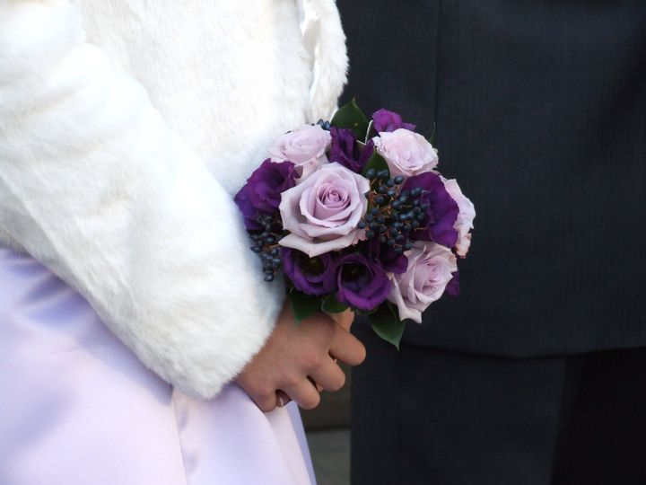 Bridesmaid bouquet in shades of purple.