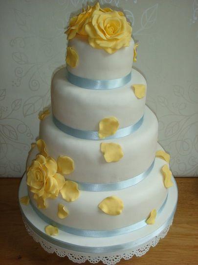 Yellow rose blue ribbon wedding cake