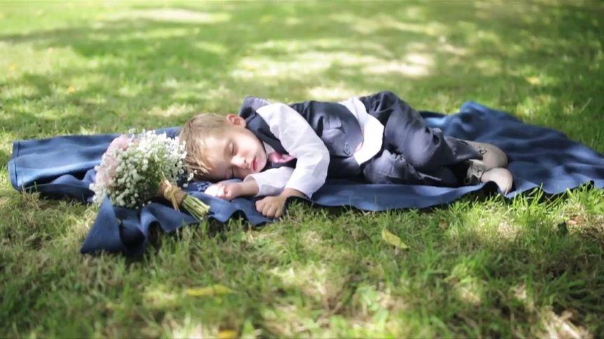 Pageboy asleep under a tree
