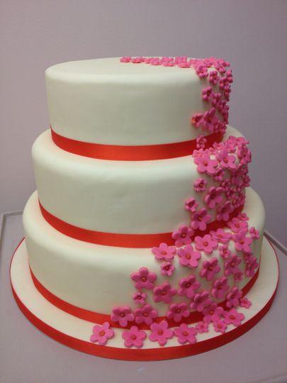 Cascading flower wedding cake