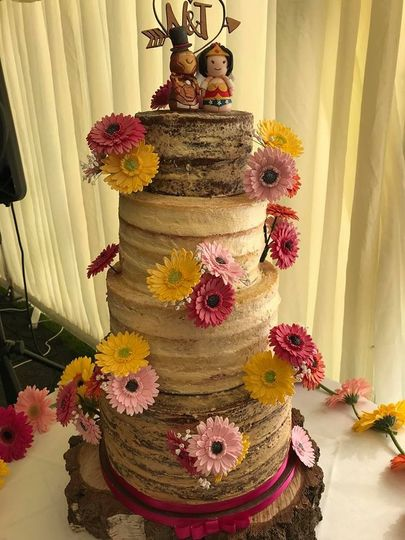 Naked cake with sugar gerberas