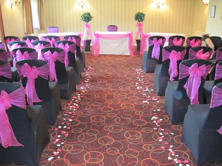 Black covers and aisle decor