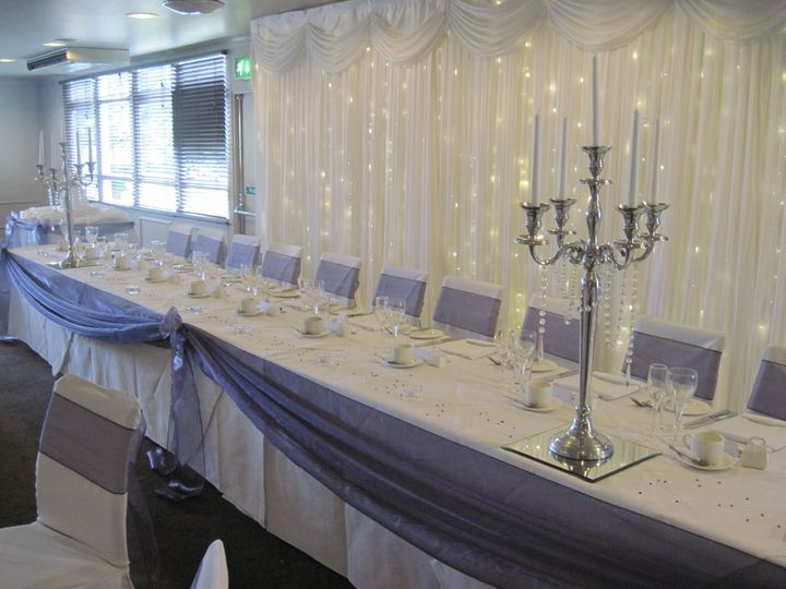 Tiwnkle backdrop candelabra and chair covers