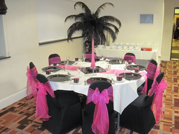 Black feathers and black chair covers