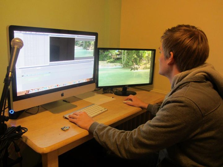 At the editing Suite cutting some Laos footage together for a highlights video.