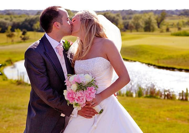 Bride and Groom on the green at the Shire Golf Club in Barnet