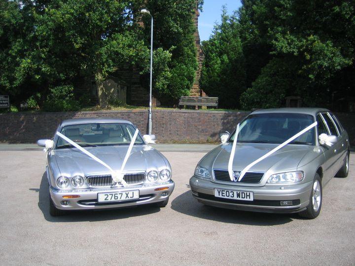 Jaguar and limo together