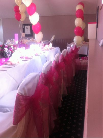 Chair covers and hot pink sash