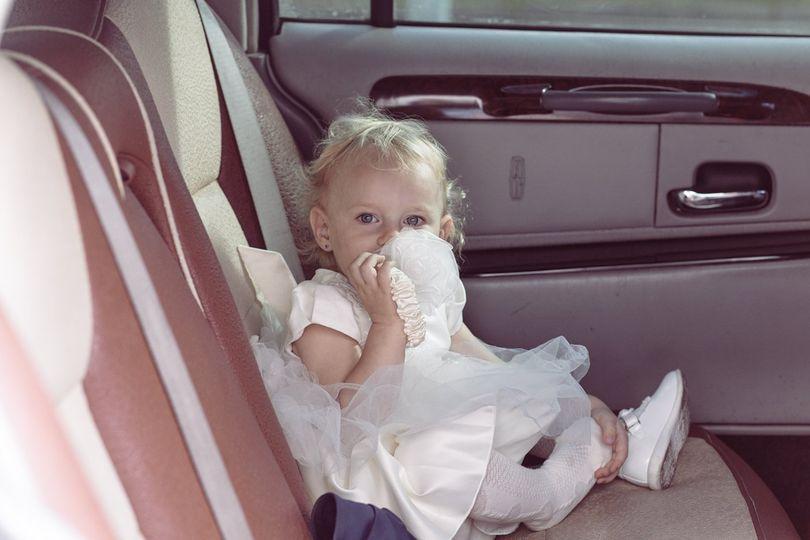 Child in bride's car