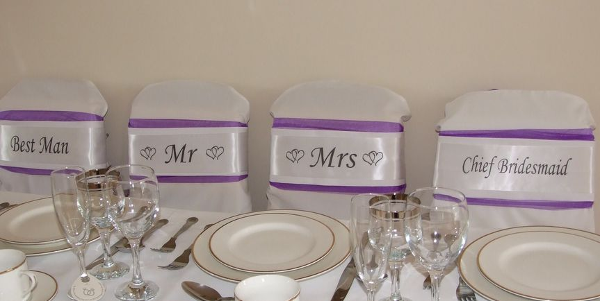Top Table sashes shown in white on deep purple organza