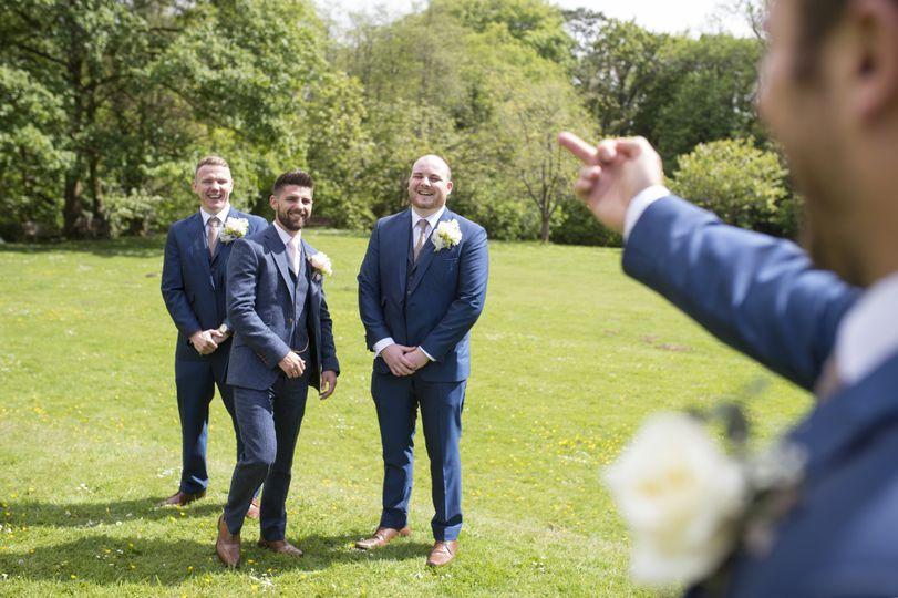 Candid groomsmen photograph